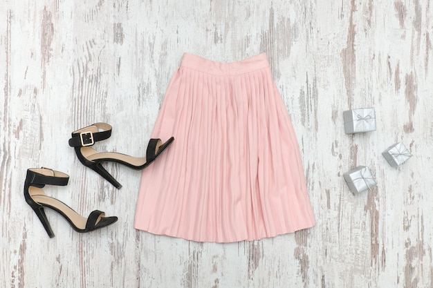 Pink skirt and black shoes.