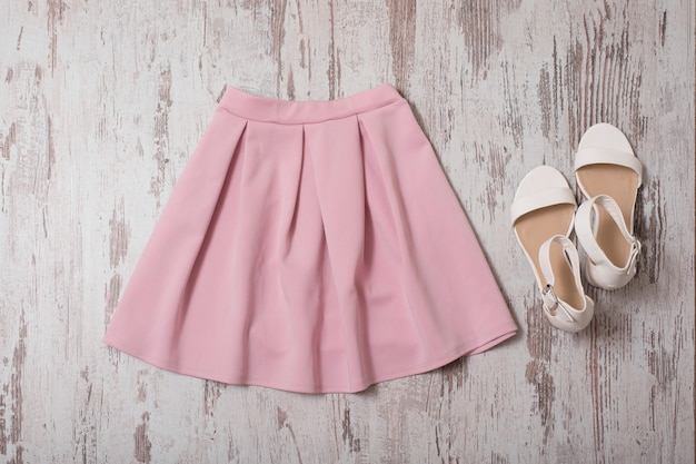 Pink skirt and white shoes. top view