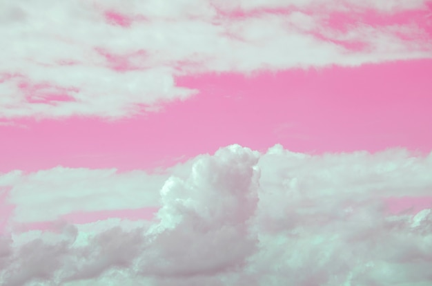 Pink sky and white clouds blurred with blurred patterned