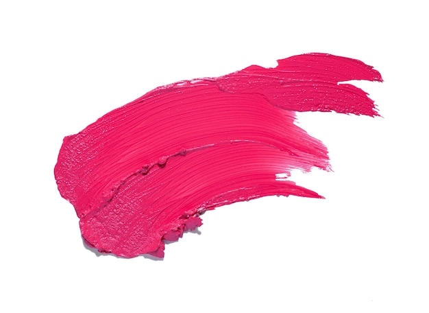 ピンクのスミアの口紅の背景のテクスチャの汚れが白で隔離