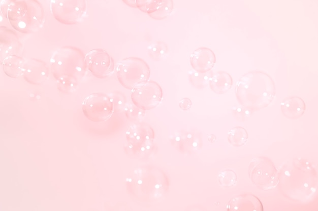 Pink soap bubbles float background