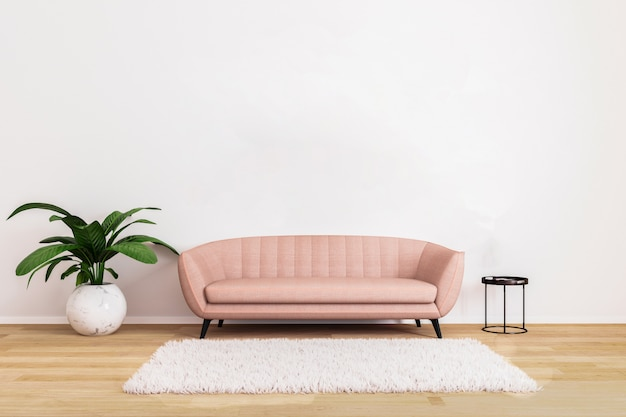Pink sofa with black coffee table and plant in bright living room with white wall and wooden floor