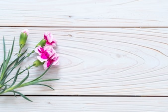 Pink spring flower on wooden background