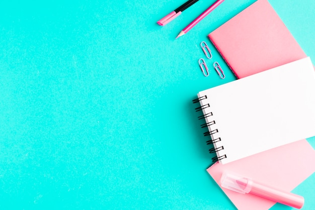 Pink stationery on colored surface