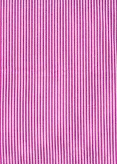 핑크 스트라이프 식탁보 배경 텍스처입니다. 패브릭 벽지