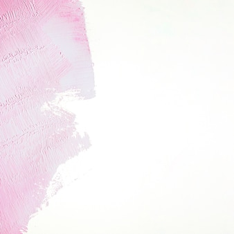 Pink stroke on white wall Free Photo