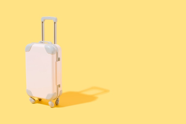 Pink suitcase on yellow background concept of travel and summer 3d illustration copy space