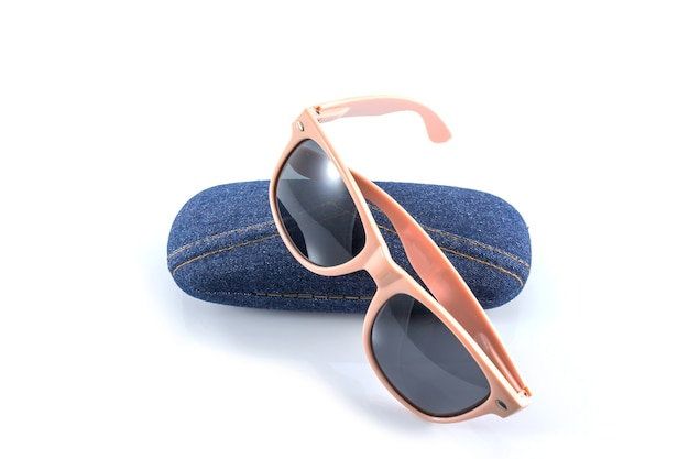 Pink sunglasses in jean case