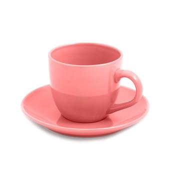 Розовая чашка и блюдце изолированные