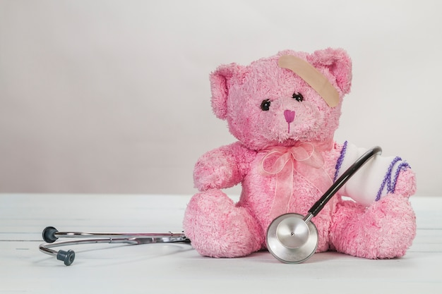 Pink teddy bear with stethoscope