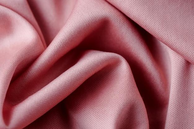 ピンクのテキスタイル抽象的な背景。閉じる
