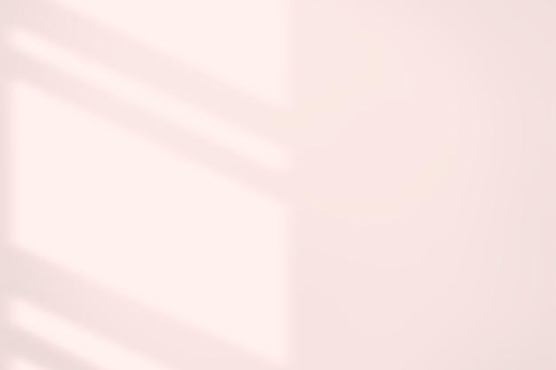Fondo strutturato rosa con l'ombra della finestra