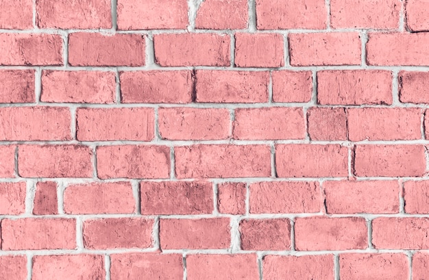 Pink textured brick wall background