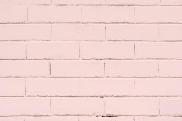 ピンクの織り目加工のレンガの壁