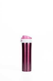 Pink thermos bottle isolated on white background with copy space