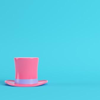 Розовый цилиндр на ярко-синем фоне