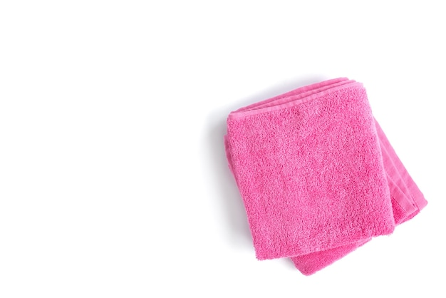 Pink towel isolated on white surface.