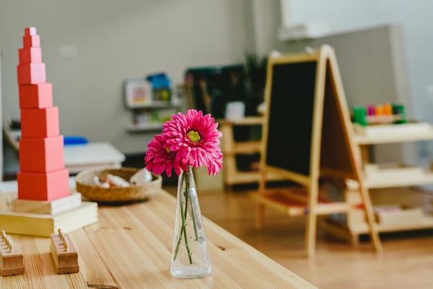 Pink tower in montessori classroom with blackboard