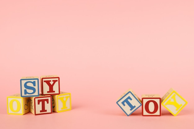 Pink  and toy colored cubes with letters