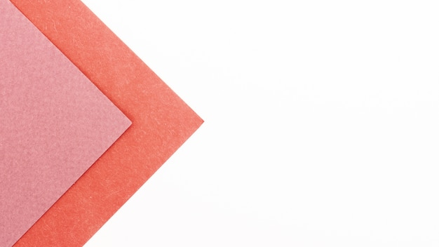 Pink triangular cardboard sheets with copy space