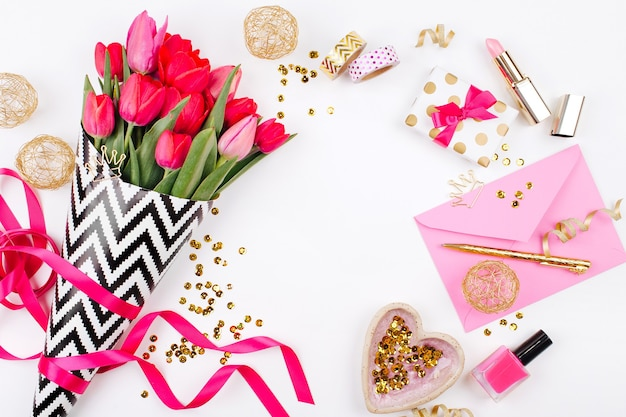 Pink tulips in black and white stylish wrapping paper gifts cosmetics and female accessories
