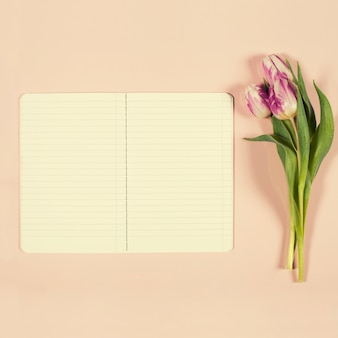Pink tulips and notebook