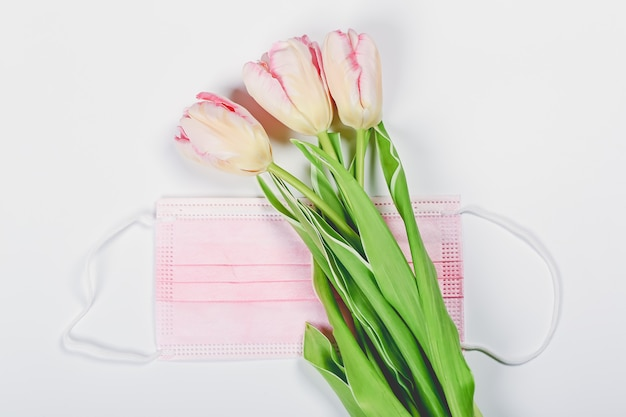 Pink tulips and pink medical mask