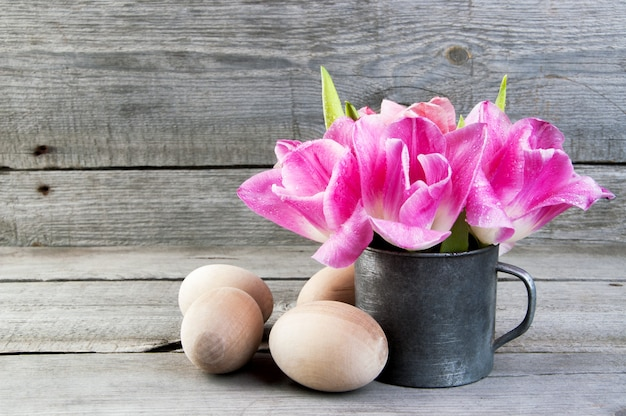 Pink tulips in vintage metal cup