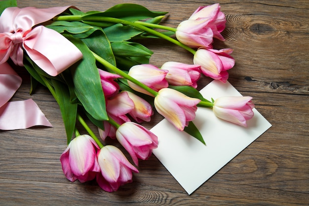 Pink tulips with postcard