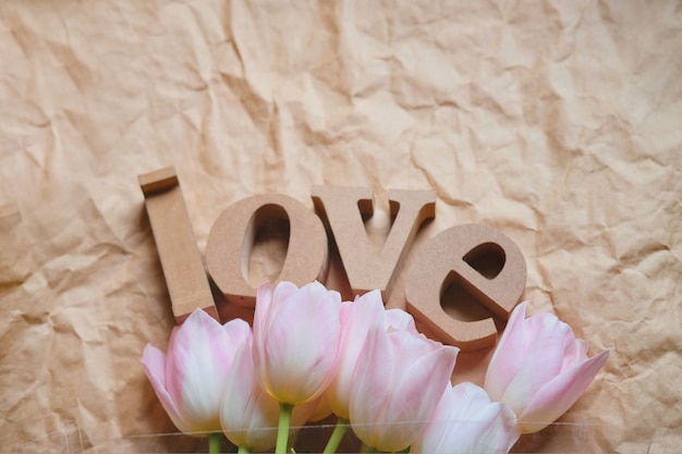 Pink tulips and wooden letters word
