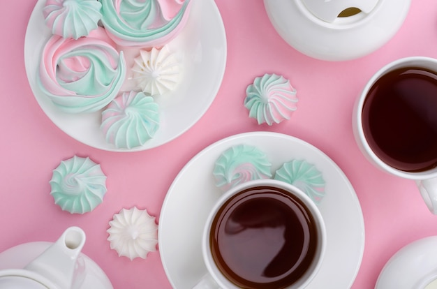 Pink turquoise meringue on a pink background. tea party.
