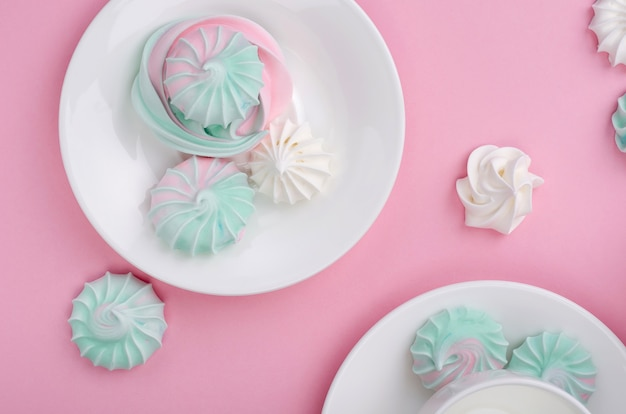 Pink turquoise meringue on a pink background.