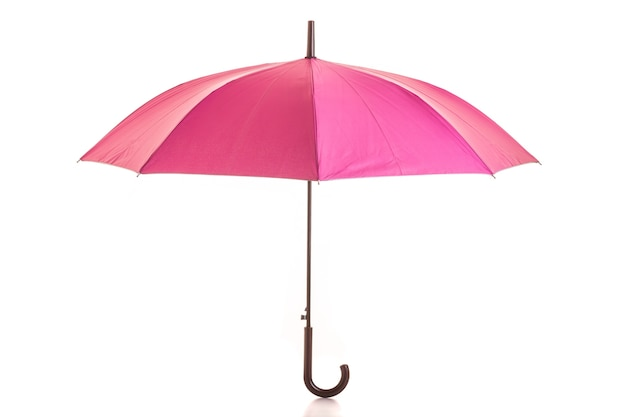 Pink umbrella isolated on white