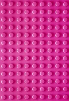ピンクの垂直プラスチック構造テクスチャ背景