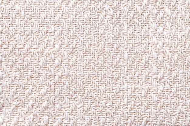 Pink vintage fabric with woven texture closeup. white textile macro background