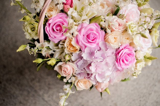 Pink and violet fresh roses bunch close up