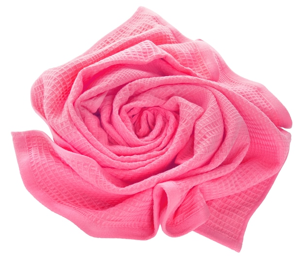 Pink waffle towel folded in the shape of a rose on a white background