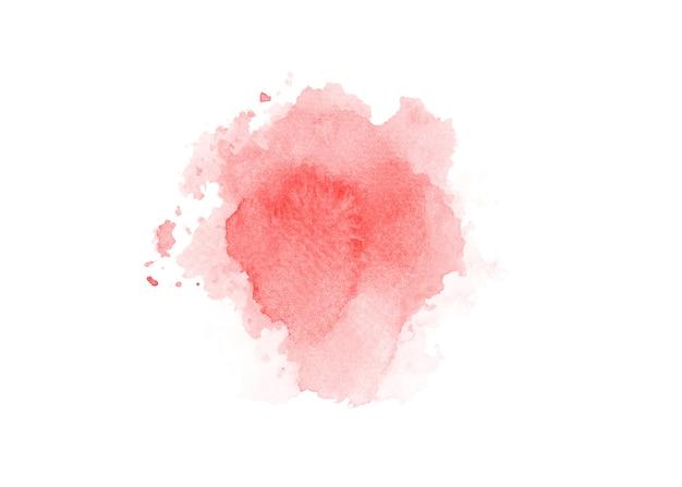 紙の背景にピンクの水彩絵の具