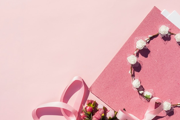 Pink wedding arrangement with flower crown and copy space