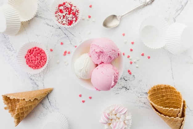 Pink and white ice cream in bowl