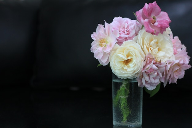 Pink white and purple roses in glass vase