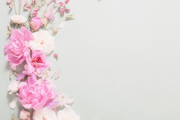 Pink and white roses on paper background