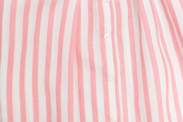 Pink and white striped seamless fabric. close up