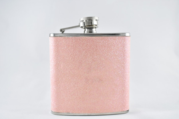 Pink women's flask for drinks on a white background