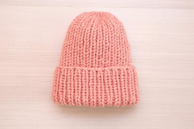 Pink women's wool hat on white background