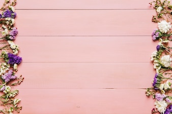 Pink wooden background with pink flowers