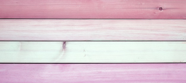 Pink wooden texture for background.