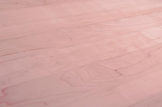 ピンクの木製の織り目加工の床の背景