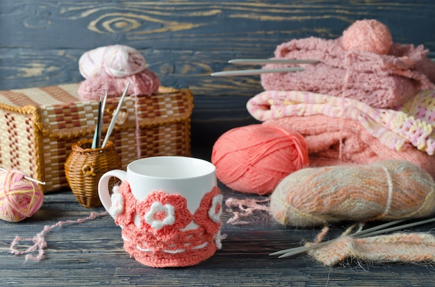 Pink yarn and craft items on a wooden table