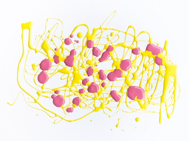 Pink and yellow paint splash on white background